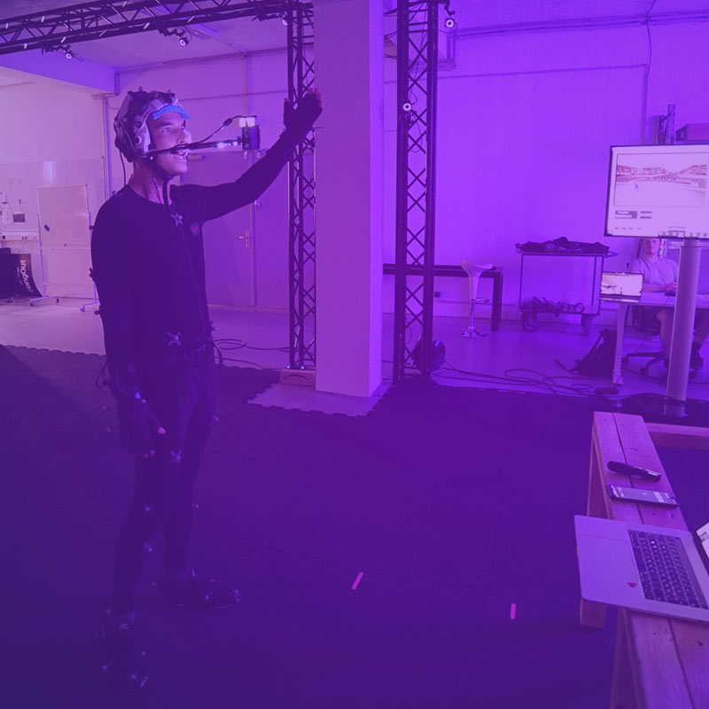 Speaker in our motion capture studio holding a live presentation in VR
